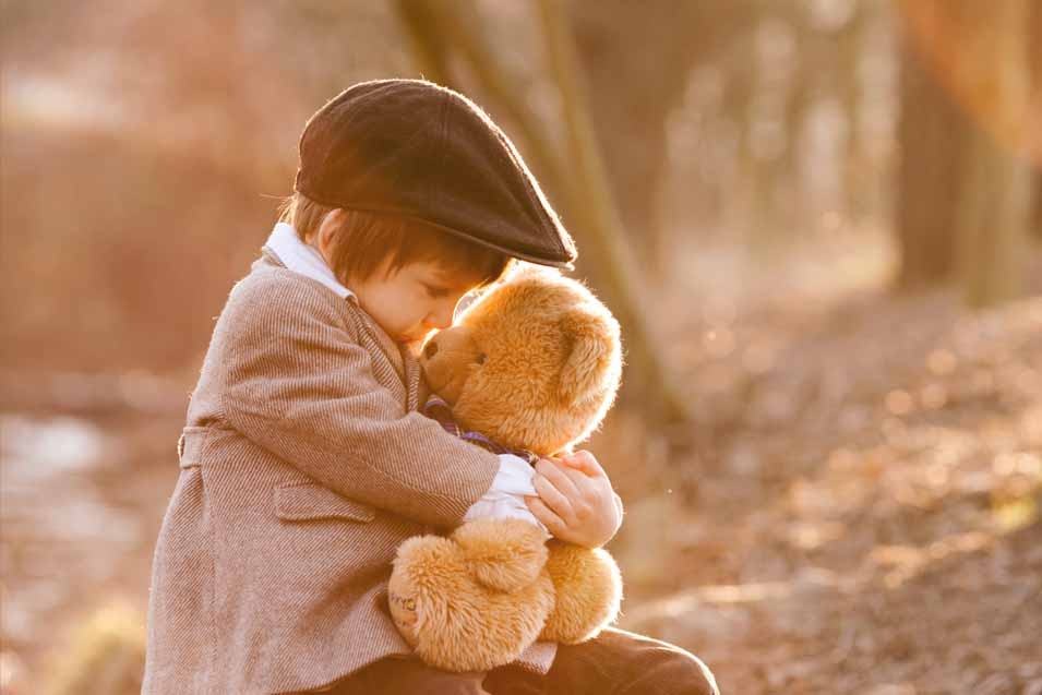 Picture of a boy holding a teddy bear